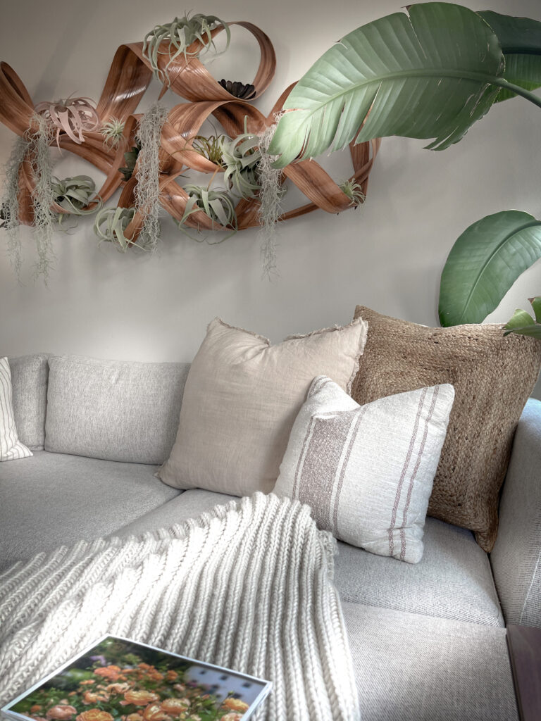 Easy steps to create a cozy home 3.  Sofa layout with cozy pillows and nature inspired artwork.